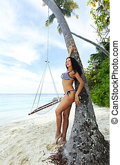 Woman near beach hammock