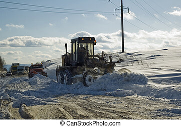 Grader removing snow - There is traffic jam from snow storm...