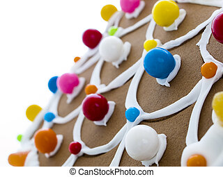 Gingerbread House - Decorated gingerbread house on white...