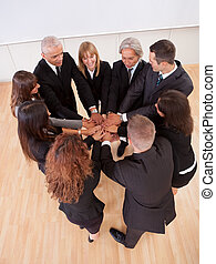 Business team pledging their support - High angle view of a...
