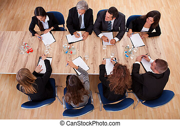 Business people in a meeting - Overhead view of a group of...