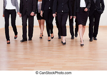 Group of business executives approaching - Large diverse...