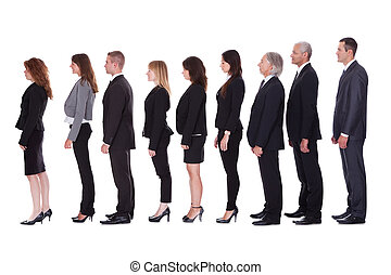 Line of business people in profile - Long line of diverse...