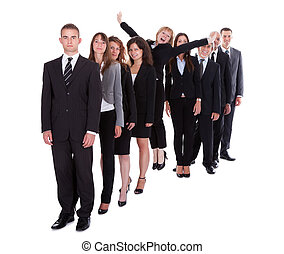 Businesswoman standing out from the crowd of her colleagues...