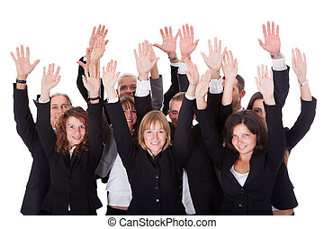 Group of business people waving in acknowledgment