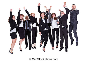 Group of jubilant business people jumping for joy and...