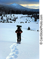 man goes on snowshoes mountains - alone man goes on...