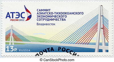 RUSSIA - CIRCA 2012: A stamp printed in Russia shows Official logo of the summit of APEC and the bridge on the Russky island, circa 2012