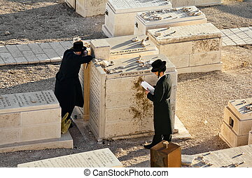 Jews pray at the graves of ancestors on the Mount of olives...