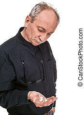 take a pill - Old man wants to take a pill isolated on white