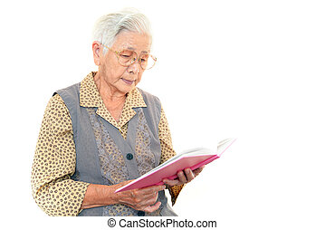 Smiling old woman - The old woman reads the book