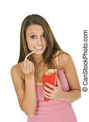 Dieting - Caucasian woman eating junk food on a white...