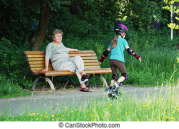 elder lady with playing child - retiree with playing child...