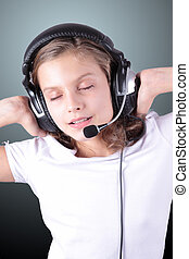 musical oblivion - a pretty girl in the headphones with a...