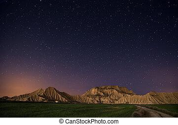 Stars over the desert - Bardenas desert at night, near...