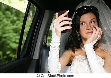 Look at mirror - Photo of happy woman in wedding dress...