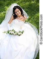 Bride on the grass - Portrait of fashion bride with bunch of...
