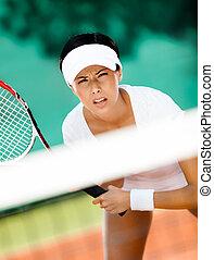 Pretty sportswoman in sportswear playing tennis - Woman in...