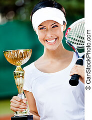 Female tennis player won the tournament - Female tennis...