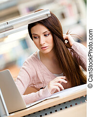 Close up of woman working on the laptop