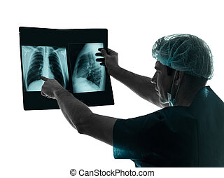 doctor surgeon radiologist examaning lung torso  x-ray image