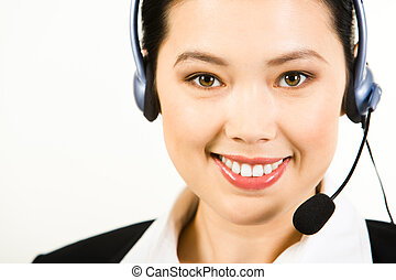 Consultant - Portrait of smiling consultant with headset...