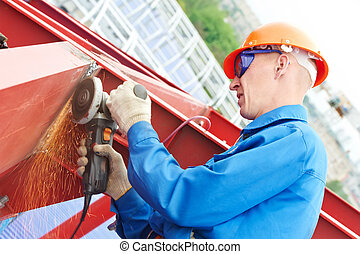 builder working with angle grinding machine