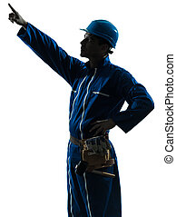 man construction worker pointing showing silhouette portrait