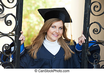 happy graduate girl - smiling happy female graduate student...