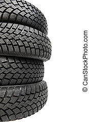 Stack of four car wheel winter tyres isolated - Stack of...