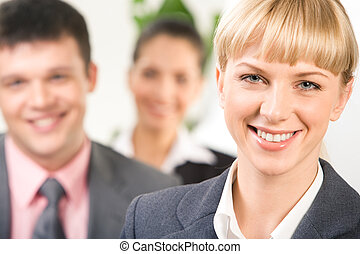 Business leader - Close-up of blonde woman looking at camera...