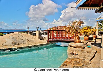 Pool side - A wooden bridge crossing over an outdoor pool