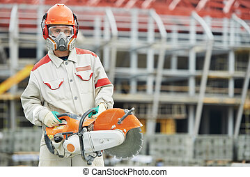 builder worker with disc cutter - construction worker in...