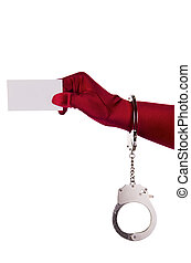 Woman holding business card - Woman in handcuffs is holding...