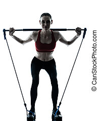 woman exercising gymstick - one caucasian woman exercising...