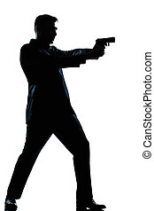 silhouette man full length shooting with gun - one caucasian...