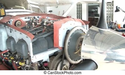 Airplane Engine Pan - Pan across open airplane engine that...