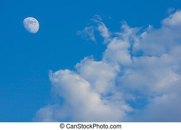 cloudy sky with moon in the evening