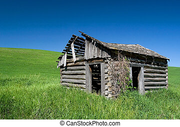 Sign of recession - Ruins of farm house in rural Idaho, USA