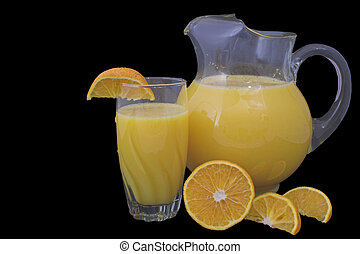 Orange Juice - Orange juice in a pitcher and drinking glass...