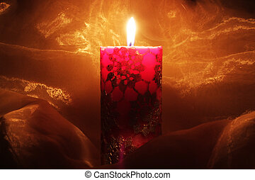 Christmas candle with fire shot in the dark