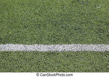 Photo of a green synthetic grass sports - field with white...
