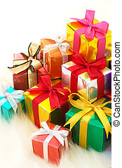 Pile of gifts on white fake fur background. (vertical) -...