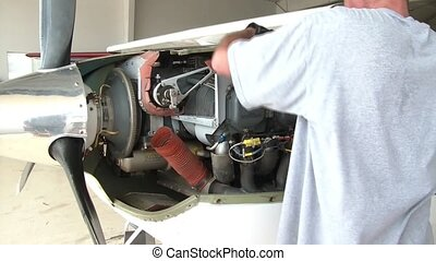 Aircract Mechanics Working on Prop Plane - Aircraft mechanic...