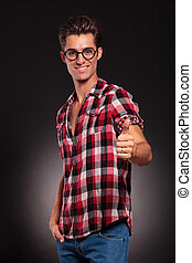 fashion man wearing glasses giving thumbs up - Happy fashion...