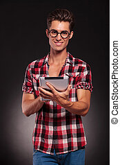 young casual man working on a tablet