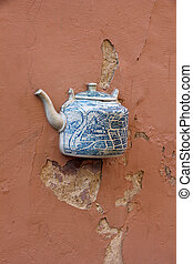 Teapot embedded in facade in Vilnius, Lithuania - A teapot,...