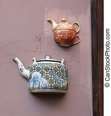 Teapots embedded in facade in Vilnius, Lithuania. - Teapots...