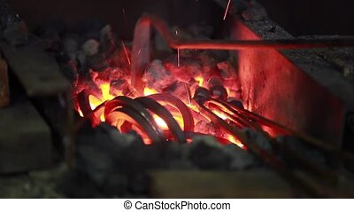 fire in the forge furnace is heated to red heat for...