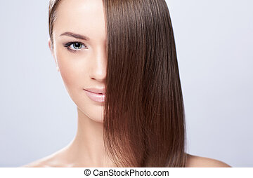 Hair care - Young girl with beautiful hair in studio